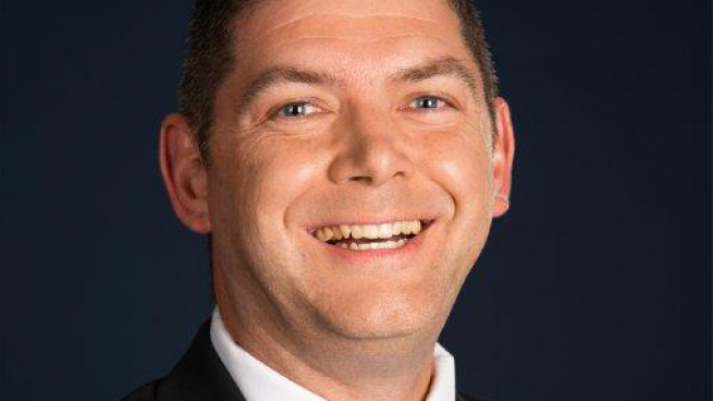 photo of smiling white man named Jesse McCollough