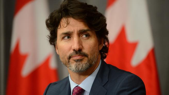 Justin Trudeau wearing a suit and tie